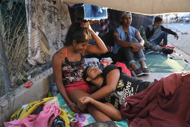"""Honduran immigrants rest at a shelter while on their journey to the U.S.-Mexico border on April 22, 2018 in Hermosillo, Mexico. Some 600 immigrants, part of a caravan of mostly Central Americans that began almost a month ago, is within days of reaching the border. Traveling together, many atop freight trains known as the """"beast,"""" they have sought safety in numbers on the dangerous journey. Along the way, they have received an outpouring of help from local charities, the Mexican Red Cross, private citizens and government officials. U.S. President Donald Trump sent National Guard troops to border regions in response to the caravan, although many in the group are families who plan to seek political asylum the U.S. (Photo by John Moore/Getty Images)"""