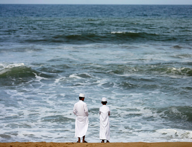 Two Muslim boys stand on the beach in the morning ahead of Eid al-Adha in Colombo, Sri Lanka September 8, 2016. (Photo by Dinuka Liyanawatte/Reuters)