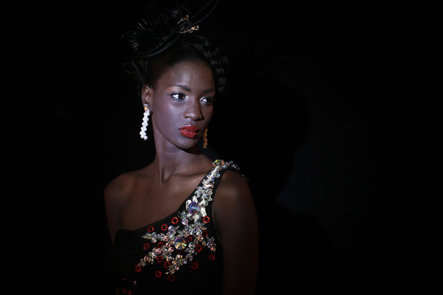Senegalese model Diarra Thiam poses for a portrait backstage during Dakar Fashion Week July 10, 2011. (Photo by Finbarr O'Reilly/Reuters)