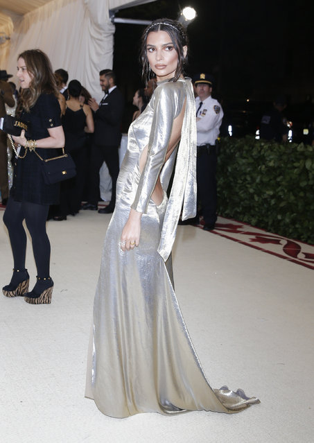 Emily Ratajkowski attends The Metropolitan Museum of Art's Costume Institute benefit gala celebrating the opening of the Heavenly Bodies: Fashion and the Catholic Imagination exhibition on Monday, May 7, 2018, in New York. (Photo by Carlo Allegri/Reuters)