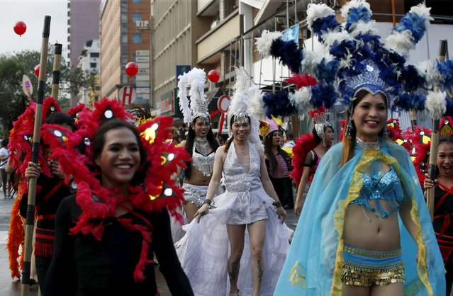 Filipino transgender women wear colourful costumes as they join a World Aids Day celebration in Manila, Philippines, December 1, 2015. (Photo by Erik De Castro/Reuters)