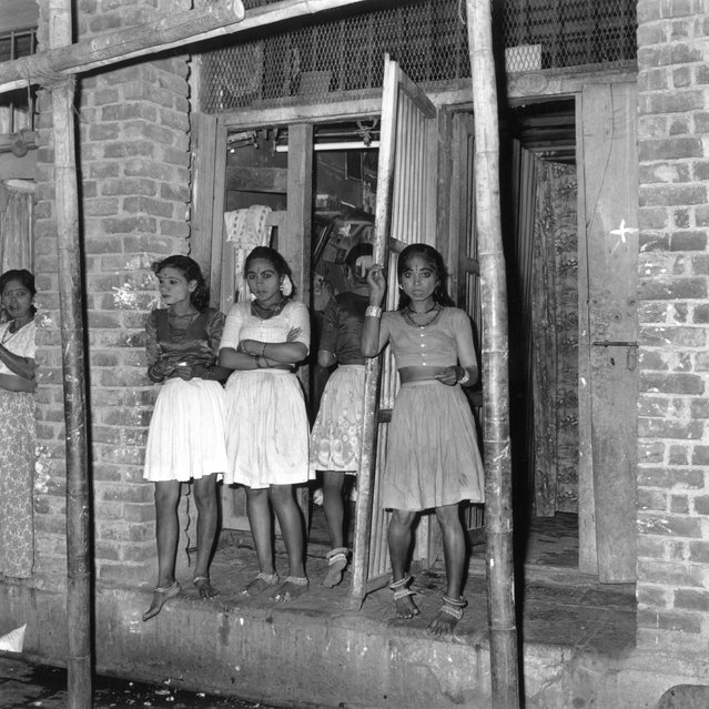 6th December 1964:  Three prostitutes waiting in a doorway in India.  (Photo by Terry Fincher/Express/Getty Images)