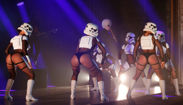 "Performers dressed like Stormtroopers dance during ""The Empire Strips Back: A Star Wars Burlesque Parody"" in Los Angeles, California, U.S., June 1, 2018. (Photo by Mario Anzuoni/Reuters)"