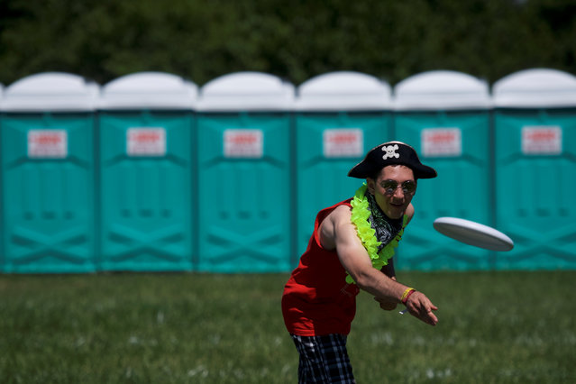A concert goer plays frisbee in a camping area during the second day of the Firefly Music Festival in Dover, Delaware June 15, 2018. (Photo by Mark Makela/Reuters)