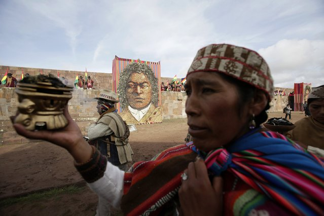 Aymara people participate a ceremony with Bolivia's President Evo Morales (not pictured) in the Tiahuanaco ruins some 70 km from La Paz, January 21, 2015. (Photo by David Mercado/Reuters)