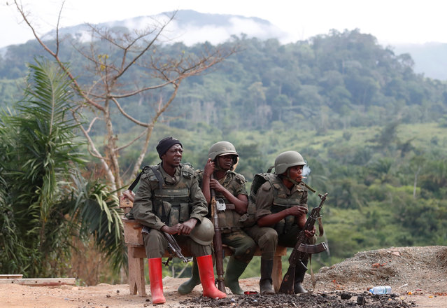 Congolese soldiers from the Armed Forces of the Democratic Republic of Congo (FARDC) rest in Namoya, Maniema Province, eastern Democratic Republic of the Congo, April 29, 2018. (Photo by Goran Tomasevic/Reuters)
