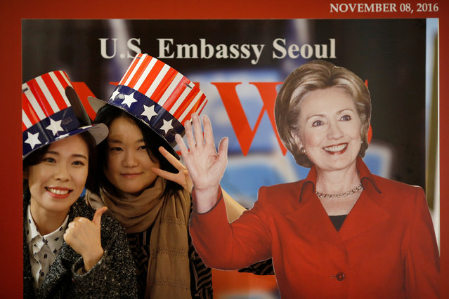 Women pose for photographs with a cut-out of Democratic U.S. presidential nominee Hillary Clinton during a U.S. Election Watch event hosted by the U.S. Embassy at a hotel in Seoul, South Korea, November 9, 2016. (Photo by Kim Hong-Ji/Reuters)