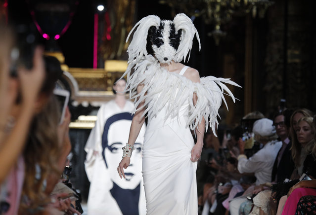 A model wears a creation for Schiaparelli Haute Couture Fall-Winter 2018/2019 fashion collection presented Monday, July 2, 2018 in Paris. (Photo by Francois Mori/AP Photo)
