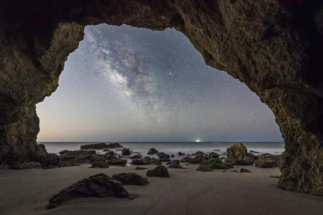 American photographer Brandon Yoshizawa framed the Milky Way inside a sea cave, 25 miles away from the heart of downtown Los Angeles. (Photo by Brandon Yoshizawa/Astronomy Photographer of the Year 2018)