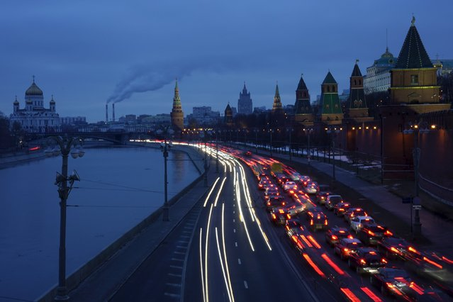 Vehicles drive along an embankment of the Moskva river near the Kremlin, with the Christ the Saviour Cathedral (L) seen in the background, in central Moscow, Russia, February 19, 2016. (Photo by Maxim Zmeyev/Reuters)