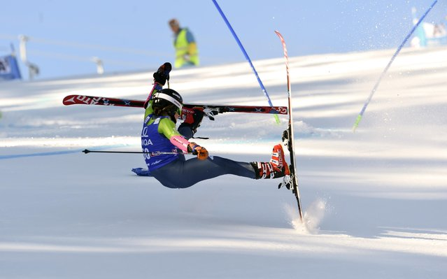 Maryna Gasienica Daniel, of Poland, falls as she competes during an alpine ski, women's World Cup giant slalom, in Lienz, Austria, Monday, December 28, 2015. (Photo by Pier Marco Tacca/AP Photo)