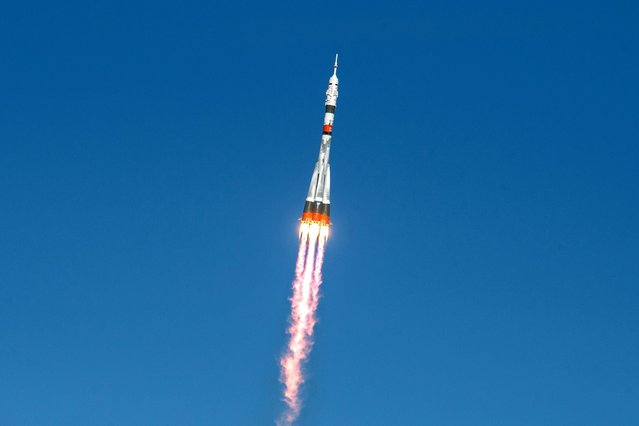 The Soyuz MS-17 spacecraft carrying the International Space Station (ISS) expedition 64 crew of NASA astronaut Kate Rubins and Russian cosmonauts Sergey Ryzhikov and Sergey Kud-Sverchkov blasts off to the ISS from the Russian-leased Baikonur cosmodrome in Kazakhstan on October 14, 2020. (Photo by Andrey Shelepin/GCTC//Reuters)