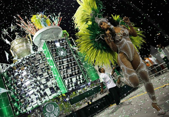 A reveller from the Mancha Verde Samba School takes part in a carnival at Anhembi Sambadrome in Sao Paulo February 14, 2015. (Photo by Nacho Doce/Reuters)