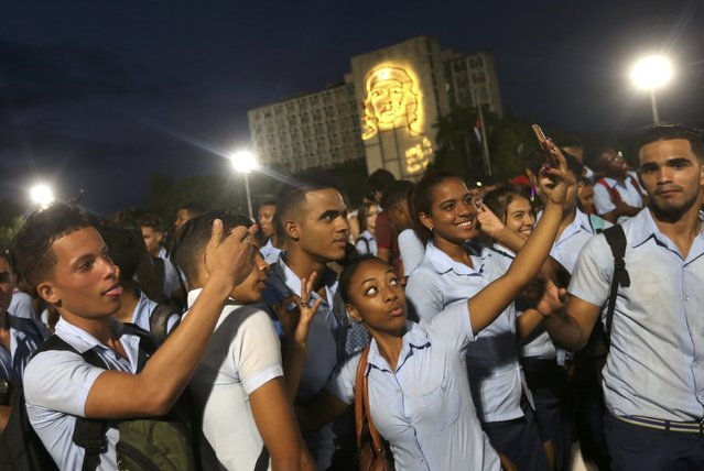 Students pose for selfies as they attend a massive tribute to Cuba's late President Fidel Castro in Revolution Square in Havana, Cuba, November 29, 2016. (Photo by Edgard Garrido/Reuters)