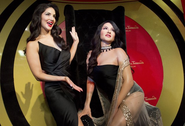 Bollywood actress and former p*rn star Sunny Leone stands with her wax likeness during its unveiling at the Madame Tussauds museum in New Delhi, India, Tuesday, September 18, 2018. (Photo by Anupam Nath/AP Photo)