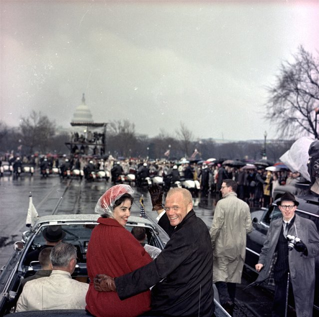 In this February 26, 1962 file photo, Mercury astronaut John Glenn, and his wife, Annie, ride in the back of an open car with Vice-President Johnson during a parade in Glenn's honor in Washington. The Capitol is seen in the background. Glenn, the first American to orbit Earth who later spent 24 years representing Ohio in the Senate, died Thursday, Dec. 8, 2016, at the age of 95. (Photo by AP Photo)