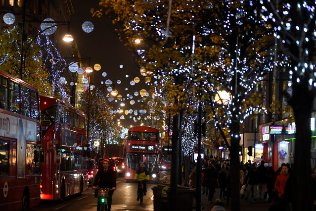 Christmas lights are seen illuminated on Oxford Street in London, Britain December 9, 2016. (Photo by Clodagh Kilcoyne/Reuters)