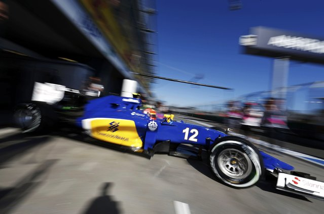 Sauber Formula One driver Felipe Nasr of Brazil drives out of his garage during the second practice session of the Australian F1 Grand Prix at the Albert Park circuit in Melbourne March 13, 2015. REUTERS/Brandon Malone