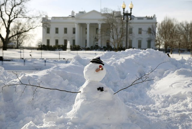 A snowman stands in front of the White House in Washington January 25, 2016. The Washington area is digging out from the weekend blizzard. (Photo by Kevin Lamarque/Reuters)