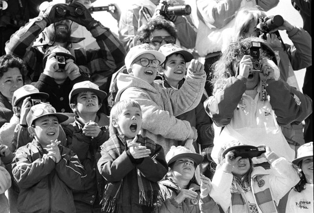 Classmates of the son of America's first school teacher astronaut cheer as the space shuttle Challenger lifts skyward from Pad 39B, January 28, 1986. Their delight soon turned into horror as the shuttle exploded about 70 seconds into flight. The boy in the white hat and glasses at center is not a schoolmate but is Peter Billingsley, spokesman for the young astronaut program. (Photo by Jim Cole/AP Photo)