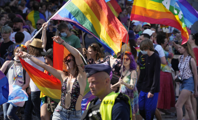 People take part in the Equality Parade, the largest gay pride parade in central and eastern Europe, in Warsaw, Poland, Saturday June 19, 2021. The event has returned this year after a pandemic-induced break last year and amid a backlash in Poland and Hungary against LGBT rights. (Photo by Czarek Sokolowski/AP Photo)