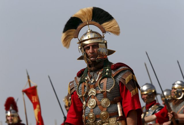 "Members of the Legio X Fretensis (Malta) re-enactment group take part in a display of ancient Roman army life at Fort Rinella in Kalkara, outside Valletta, March 22, 2015. The event ""Romanus"", organised by the Malta Heritage Trust, consisted of talks, hands-on displays, static exhibitions of weapons and equipment, food and wine tasting and large-scale re-enactments depicting different forms of Roman warfare in the field. (Photo by Darrin Zammit Lupi/Reuters)"