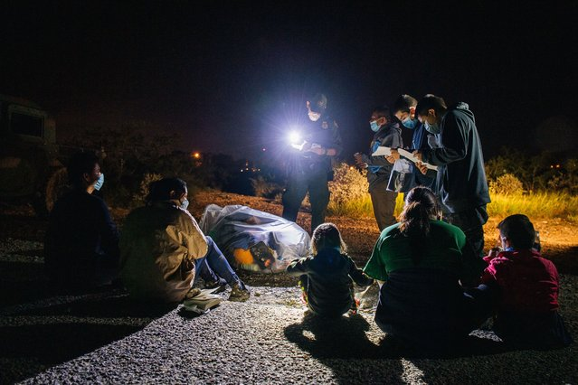 Migrants are accounted for and processed by border patrol after crossing the Rio Grande into the United States on July 01, 2021 in Roma, Texas. Recently, Texas Gov. Greg Abbott has pledged to build a state-funded border wall as a surge of mostly Central American immigrants crossing into the United States continues to challenge U.S. immigration agencies. So far in 2021, the border patrol has apprehended more than 900,000 immigrants crossing into the U.S. from Mexico. (Photo by Brandon Bell/Getty Images)