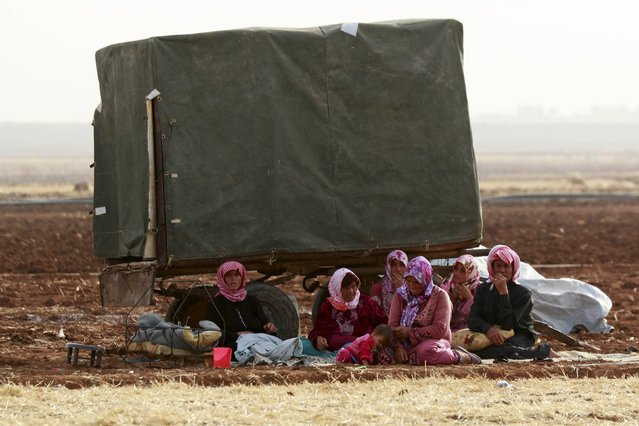 Syrians who fled recent fightings in their area rest in the southern countryside of Aleppo, Syria October 21, 2015. (Photo by Hosam Katan/Reuters)