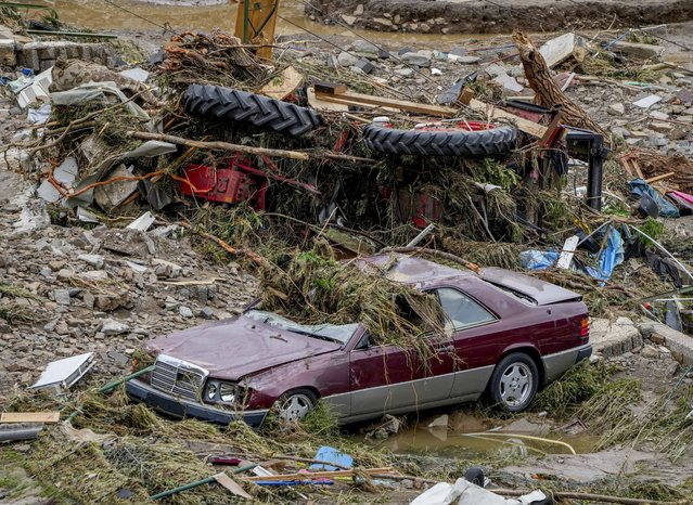 Destroyed cars are seen in Schuld, Germany, Thursday, July 15, 2021. Due to heavy rain falls the Ahr river dramatically went over the banks the evening before. People have died and dozens of people are missing in Germany after heavy flooding turned streams and streets into raging torrents, sweeping away cars and causing some buildings to collapse. (Photo by Michael Probst/AP Photo)