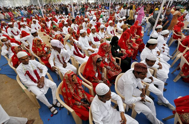 Brides and grooms take part in a mass marriage ceremony in the western Indian city of Ahmedabad March 21, 2015. (Photo by Amit Dave/Reuters)