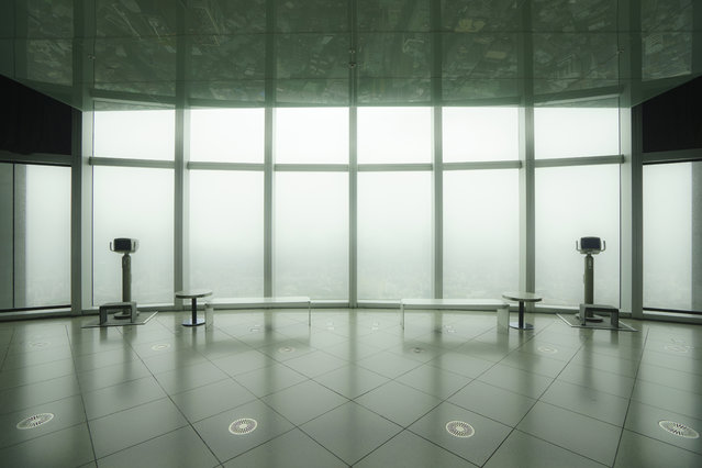 """Absence"". The empty observation deck on a rainy Sunday, having some sense of tranquility. The view of the Metropolis was veiled in a haze, but the nearby buildings were rather clearly reflected on the ceiling. Photo location: Roppingi, Tokyo, Japan. (Photo and caption by Takeo Hirose/National Geographic Photo Contest)"