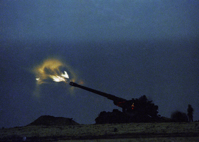 In this January 28, 1991 file photo, U.S. Marines located just a few miles from Kuwait, fire an ordinance  at Iraqi positions inside Kuwait in eastern Saudi Arabia. Twenty five years after the first U.S. Marines swept across the border into Kuwait in the 1991 Gulf War, American forces find themselves battling the extremist Islamic State group, born out of al-Qaida, in the splintered territories of Iraq and Syria. The Arab allies that joined the 1991 coalition are fighting their own conflicts both at home and abroad, as Iran vies for greater regional power following a nuclear deal with world powers. (Photo by Sadayuki Mikami/AP Photo/DOD Pool)