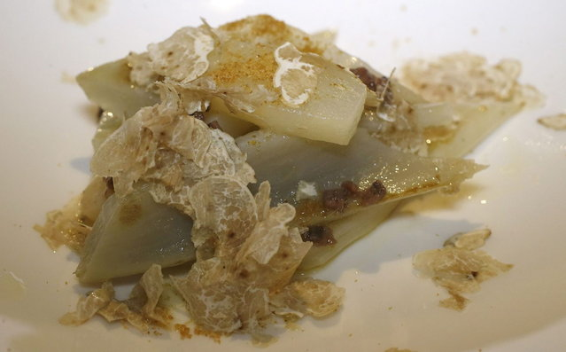 Cardoon with white truffle and pear is seen at the Guido restaurant in Serralunga d'Alba, in north-western Italy November 11, 2013. (Photo by Stefano Rellandini/Reuters)