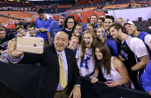 Broadcaster Dick Vitale poses for a photo with Duke fans before the NCAA Final Four college basketball tournament championship game between Wisconsin and Duke Monday, April 6, 2015, in Indianapolis. (Photo by David J. Phillip/AP Photo)