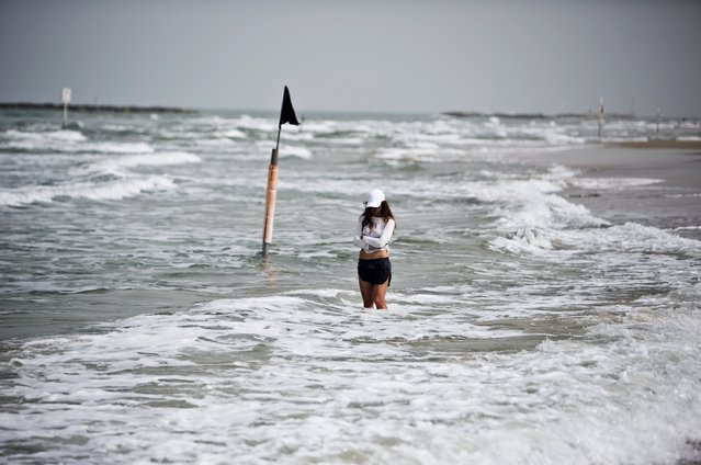 A beach-goer stands still as a two-minute siren marking Holocaust Remembrance Day is sounded in Tel Aviv April 16, 2015. (Photo by Nir Elias/Reuters)