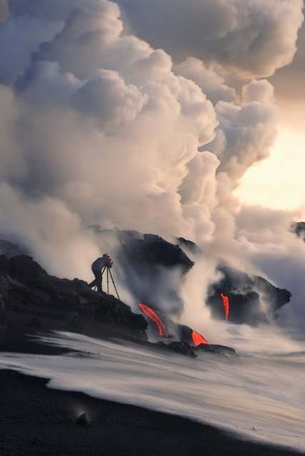 Photographer captures the Lava flow from the Kilauea Volcano as it enters the sea south of Kalapana in Big Island, Hawaii. (Photo by Miles Morgan/Barcroft Media)