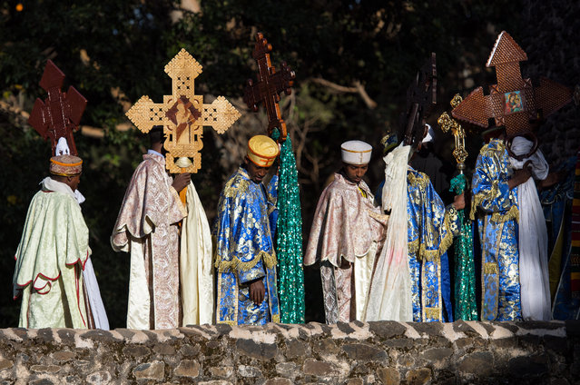 Ethiopian Orthodox priests wait to enter the tower at Fasilides Bath during the annual Timkat epiphany celebration on January 18, 2017 in Gondar, Ethiopia. (Photo by Carl Court/Getty Images)
