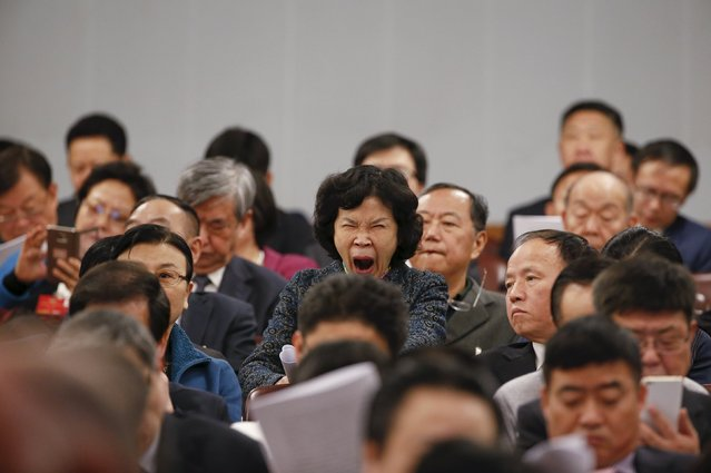 A delegate yawns during the opening session of the National People's Congress (NPC) at the Great Hall of the People in Beijing, China, March 5, 2016. (Photo by Kim Kyung-hoon/Reuters)