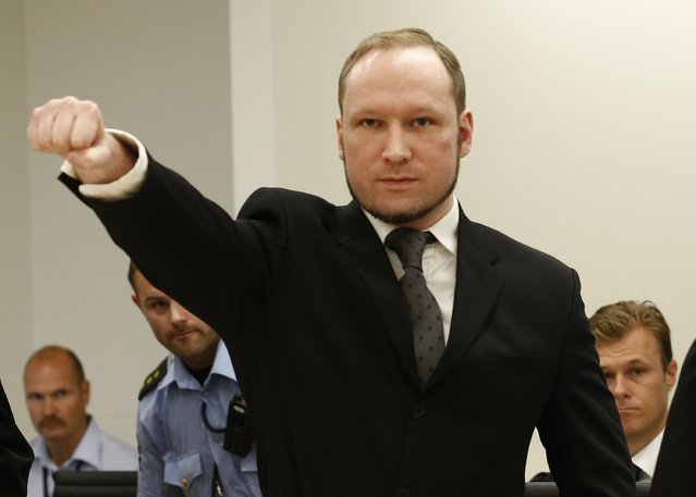 Self confessed mass murderer Anders Behring Breivik raises his fist in a right wing salute on arrival court room 250 at Oslo central court on August 24, 2012 to be sentenced for his twin attacks last year that left 77 people dead, bringing to a close one of the most spectacular trials in Norway's history. (Photo by Heiko Junge/AFP Photo)