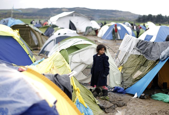 A migrant girl stands among tents at a makeshift camp on the Greek-Macedonian border near the village of Idomeni, Greece March 10, 2016. (Photo by Stoyan Nenov/Reuters)
