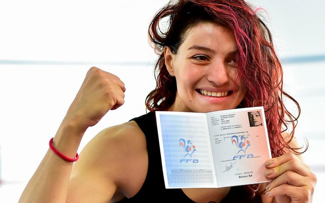 """Iranian boxer Sadaf Khadem reacts after receiving her sport license during a training session in a gymnasium in Royan, southwestern France, on April 11, 2019 ahead of her first fight. Iranian boxer Sadaf Khadem, 24, has received her sports license. She will finally be able to take part in her first official fight, on April 13, 2019 during a short stay in France. """"It's historic! This is the first fight of an Iranian who is validated, registered with real referees by a national federation. It is the first official fight of an Iranian"""" in the English boxing speciality, assures Mahyar Monshipour, in charge of the organisation. (Photo by Georges Gobet/AFP Photo)"""