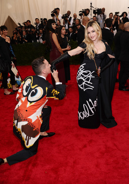 "Jeremy Scott, left, and Madonna arrive at The Metropolitan Museum of Art's Costume Institute benefit gala celebrating ""China: Through the Looking Glass"" on Monday, May 4, 2015, in New York. (Photo by Charles Sykes/Invision/AP Photo)"
