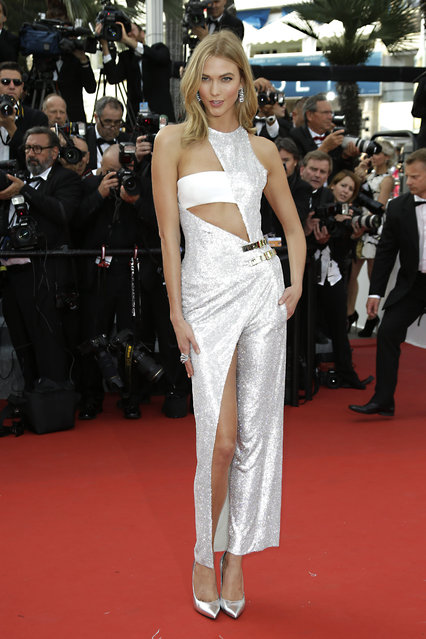 Karlie Kloss arrives for the opening ceremony and the screening of the film La Tete Haute (Standing Tall) at the 68th international film festival, Cannes, southern France, Wednesday, May 13, 2015. (Photo by Joel Ryan/Invision/AP Photo)