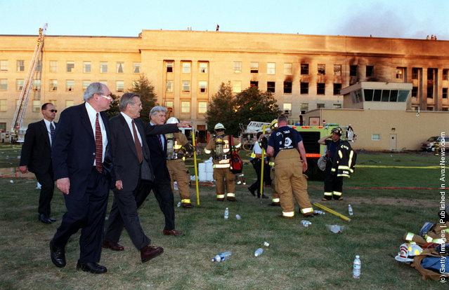 U.S. Secretary of Defense Donald H. Rumsfeld (C) leads Sen. Carl Levin (L), D-Mich., and Sen. John Warner (R), R-Va., to the crash scene at the Pentagon heliport September 11, 2001
