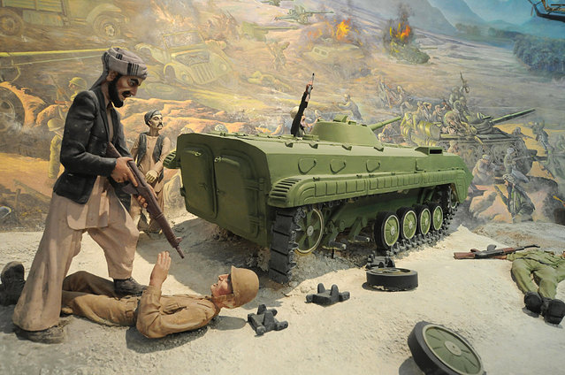 Detail of a tableau depicting fighting during the Soviet invasion of Afghanistan at the Jihad Museum, on August 8, 2009. (Photo by Shah Marai/AFP Photo via The Atlantic)