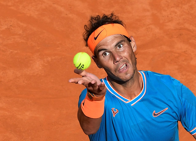 Rafael Nadal of Spain plays a forehand against Stefanos Tsitsipas of Greece in their semifinal match during day seven of the International BNL d'Italia at Foro Italico on May 18, 2019 in Rome, Italy. (Photo by Giuseppe Maffia/Reuters)