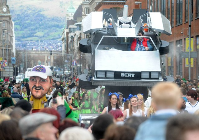 Golfer Graeme McDowell and Marty McFly in the 'Back to the Future' De Lorean wave to the crowd as the annual St Patrick's Day Parade passes through Belfast watched by thousands thronging the route from the city hall to the Custom House Square where the crowd were entertained at an open-air concert headlined by former X-Factor winner Shayne Ward. (Photo by Alan Lewis)