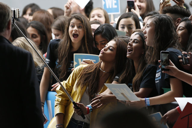 Singer Selena Gomez poses for a selfie stick photo with students as she arrives at We Day California in Inglewood, California, April 7, 2016. (Photo by Danny Moloshok/Reuters)
