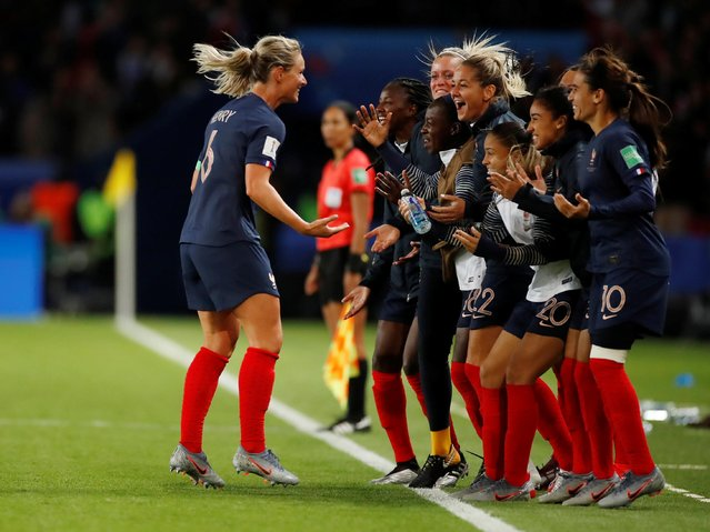 France's Amandine Henry, left, celebrates after scoring her side's fourth goal during the Group A soccer match between France and South Korea on the occasion of the Women's World Cup at the Parc des Princes in Paris, Friday, June 7, 2019. (Photo by Christian Hartmann/Reuters)