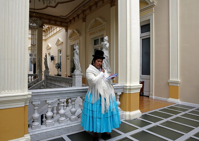 """Elizabeth Mamani, 36, a reporter at Radio Union, poses inside Bolivia's national congress building in La Paz, Bolivia, February 22, 2017. """"When I started in this job, I did feel discrimination (from officials who controlled the access of members of the press to events). To counter discrimination in this profession, we as women, must excel, we must prepare ourselves in every field"""", Mamani said. (Photo by David Mercado/Reuters)"""